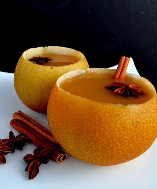 Warm Pear Cider served in Asian pear cups -- easy to make and so delicious on a crisp autumn day.