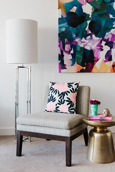 Rushcutters Bay Apartment - Emma Blomfield Interior Stylist Sydney. Living Room. Floral Cushion. Patterned Chair. Side Table Styling. Bold Wall Art. Touch of Pink.