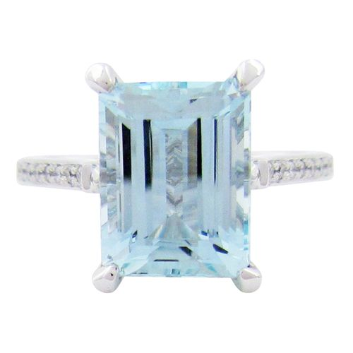 AQUAMARINE MEADOW RING IN WHITE GOLD  A 14 karat white gold 4 prong Meadow ring carries a 3.46TCW Aquamarine. 20 x 1mm of round brilliant diamonds with SI clarity and F/G colour adorn the half eternity of this ring. This Aquamarine ring is a size 6.5 which can also be sized. (R573)