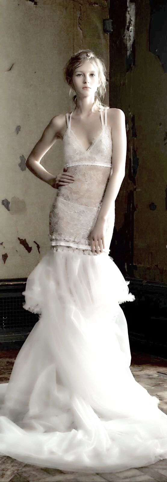 #VeraWang2016 - #Pinterestcolour - Light ivory V-neck hand applique Chantilly lace mermaid gown with pleated ribbon and silk flower details accented by tumbled hand pleated tulle skirt and plunging back with silk flower embroidered straps. Styled with Chantilly lace bra and panty with silk flower applique on the bra.
