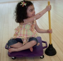 Good ideas for building core strength/trunk rotation/bilateral coordination [I personally love the idea of rowing a scooter board w/ a plunger. There are more ideas at the site. Would even work in a school where treating in the hallway is required]