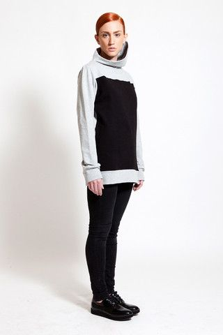 Love the assymetric turtle neck of this two-toned sweatshirt. Find it at www.ozonboutique.com