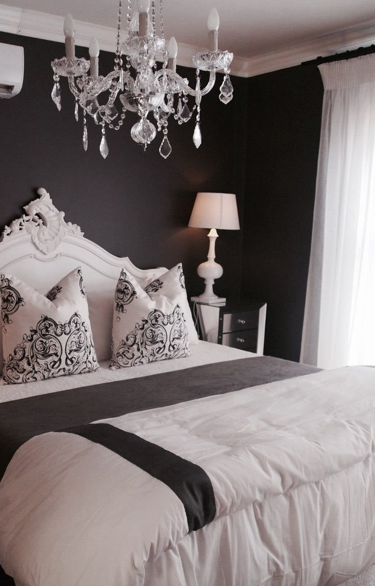 Monochrom French Main Bedroom.  Dark wall, white french headboard & crystal chandelier