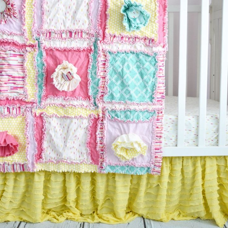 Beautiful handmade Custom pink ruffle bedding made in pink, mint, and yellow. The crib set with Ruffle flowers features Rag Quilt Style Quilt and Bumpers with frayed exposed seams for your Baby Nurser