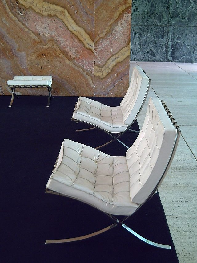 Ludwig Mies van der Rohe Barcelona Chair - love the Onyx wall behind. An interior as modern now as it was then - incredible