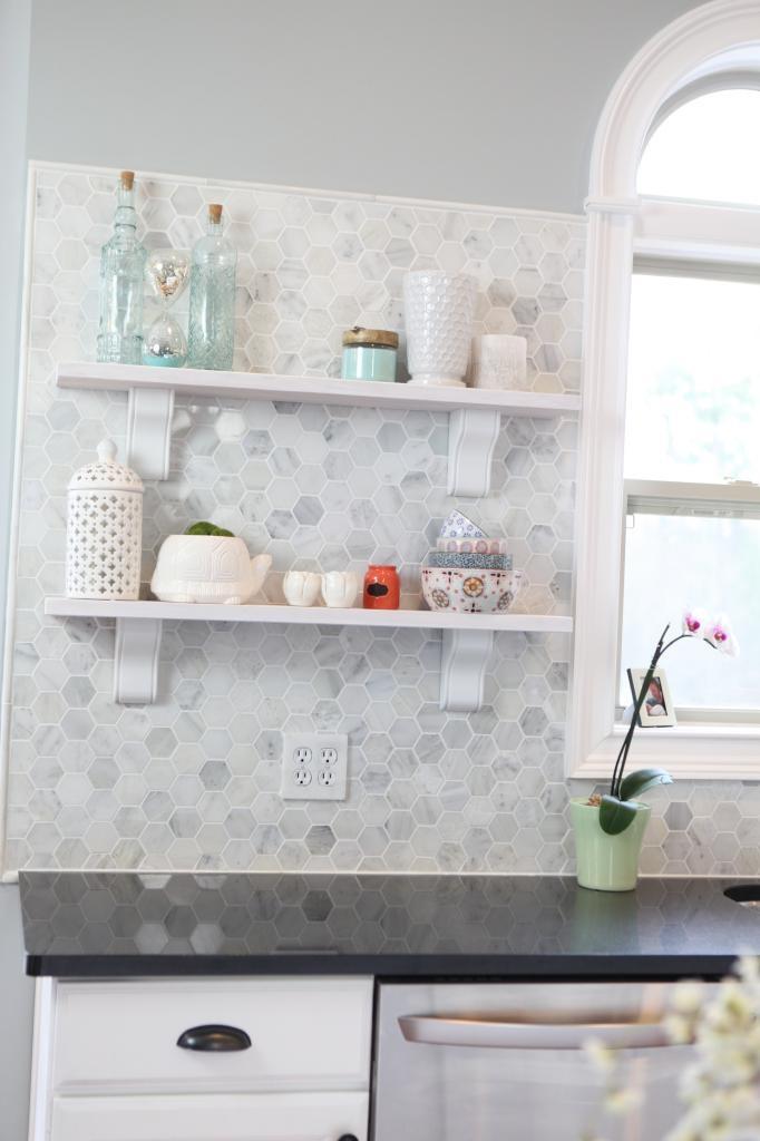 marble tile back splash and open shelves