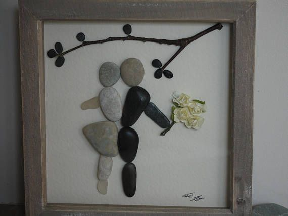 This is a beautiful handmade picture of a couple dancing under tree branches has been made using pebbles, dried wood and paper flowers which have been carefully placed and fixed with a high strength glue onto high quality hammered ivory card. The frame is approximately 9x9 inches (23.2x23.2cm) and the picture is 8x8 inches (20.2x20.2) and has a lovely rustic washed wood effect. The picture is behind glass and has wall hanger. This lovely picture is also a perfect Wedding, Engagement…