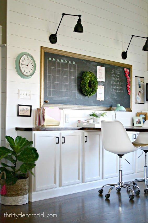 office space with large desk and chalkboard - love the ship lap walls, the wall lamps and the great storage space with narrow depth cabinets