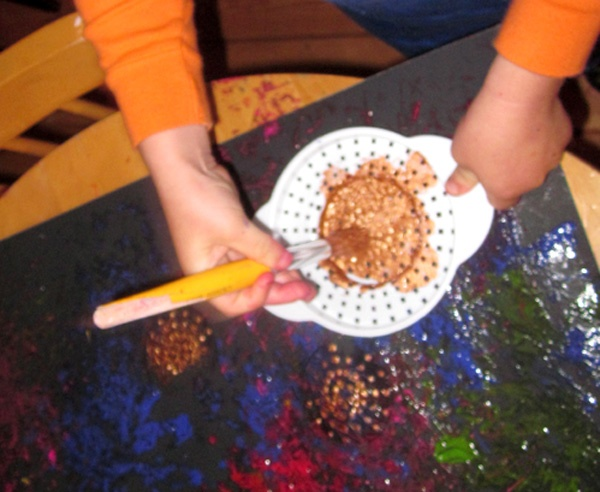 painting with can strainer - Purchase from Dollar Tree. Looks like fireworks.