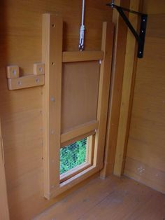 Pop door. Drops into track at the bottom so predators can't get their paws/claws under the door to lift it. So smart.