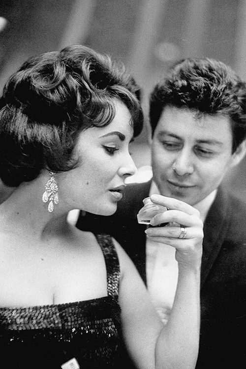 Elizabeth Taylor and Eddie Fisher attend the premiere of Smellovision, photographed by Art Shay, 1960