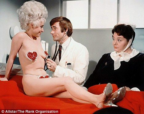 Barbara Windsor stars as Goldie Locks in a famous scene from classic Carry On Again Doctor