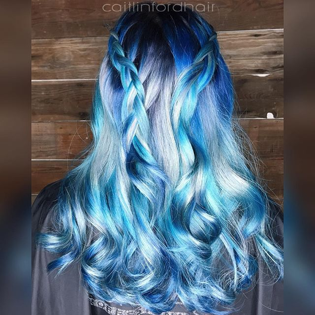 This blue and silver color melt leaves us breathless! Multiple shades of blue hair color and silver hair color by Caitlin Ford hotonbeauty.com colormelt braid