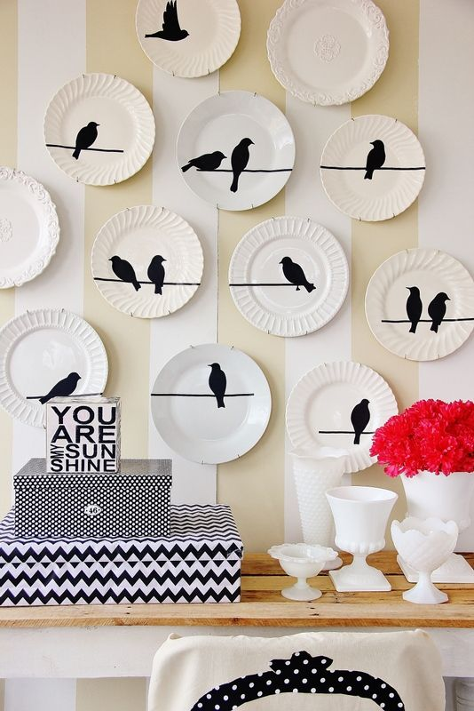 Here's a pretty way to do vinyl birds on a wire with the designs here ( http://www.myvinyldesigner.com/Products/do1215.aspx ) from Dominic. Nice!