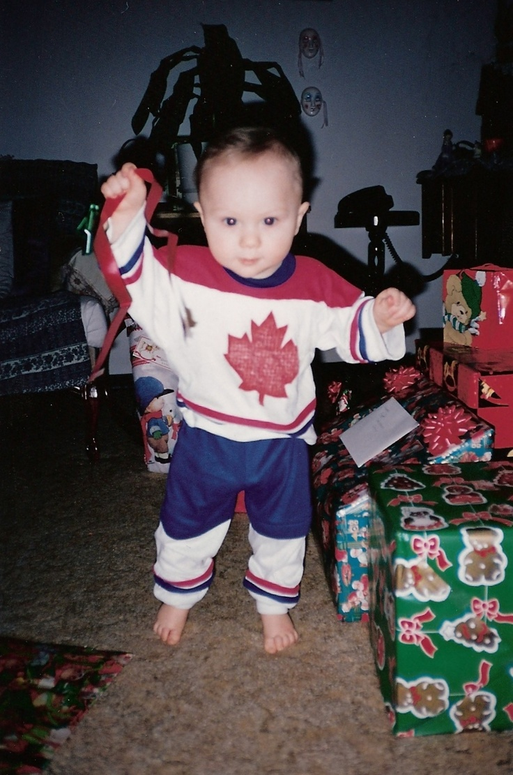 Ripping away at those presents for my first Christmas.