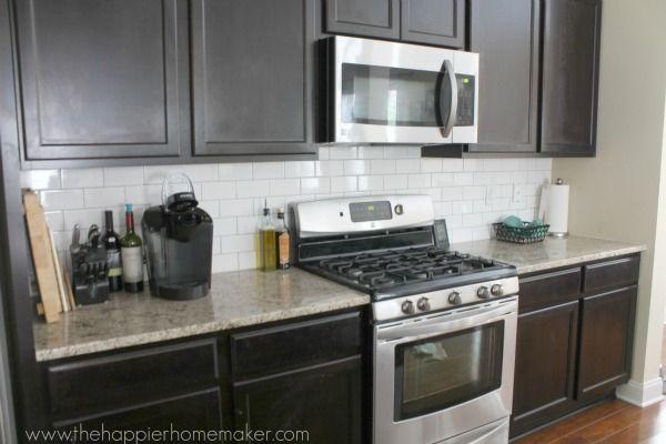 dark cabinets white subway tile back splash medium toned
