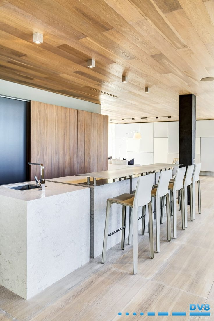 Modern Japanese bar. Stone clad solid elements formed out of the ground. Stainless steel counter top with walnut joinery. Timber clad ceiling with powder coated fireplace panels.