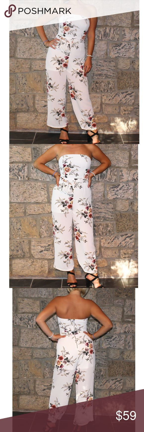 Strapless Floral Jumpsuit EMPRESS FAVE👑 This gorgeous full length white jumpsuit is covered in a beautiful multi colored floral design. Straight neck line & strapless. Floral waist tie also included, can be worn with or without. Zipper in the back. Imported from Australia 💕 Pants Jumpsuits & Rompers
