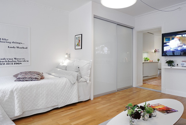 I like the small single bed in this tiny apartment very much.