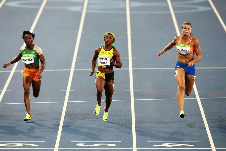 RIO DE JANEIRO, BRAZIL - AUGUST 13: Shelly-Ann Fraser-Pryce (C) of Jamaica, Marie-Josee Ta Lou of the Ivory Coast and Dafne Schippers of the Netherlands compete in the Women's 100m Semi final on Day 8 of the Rio 2016 Olympic Games at the Olympic Stadium on August 13, 2016 in Rio de Janeiro, Brazil. (Photo by Cameron Spencer/Getty Images) — in Rio de Janeiro, Brazil.