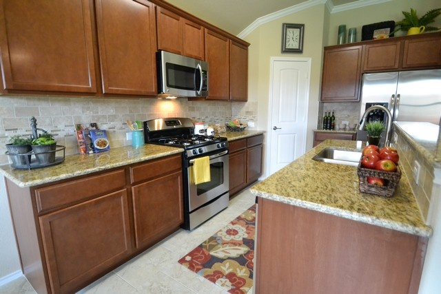 Woodlands Park Kyle Texas Kitchen with granite counter tops.