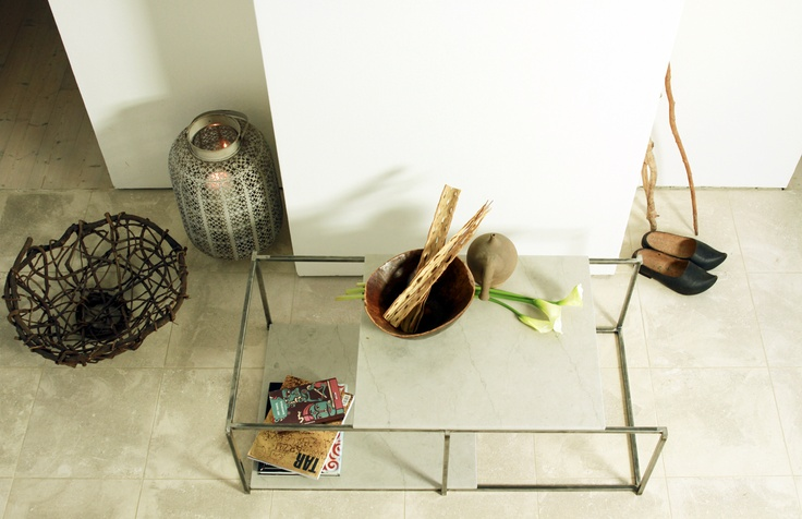 A low table, a binomium between two  materials so simple and at the same time noble as the marble and the metal.
