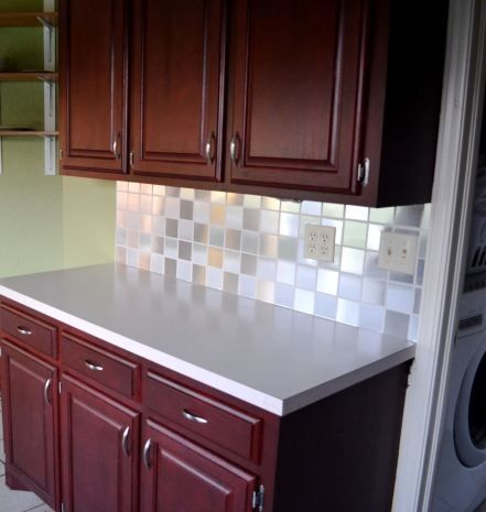 Who knew a $7 roll of contact paper from Lowes would create a simple and temporary backsplash!