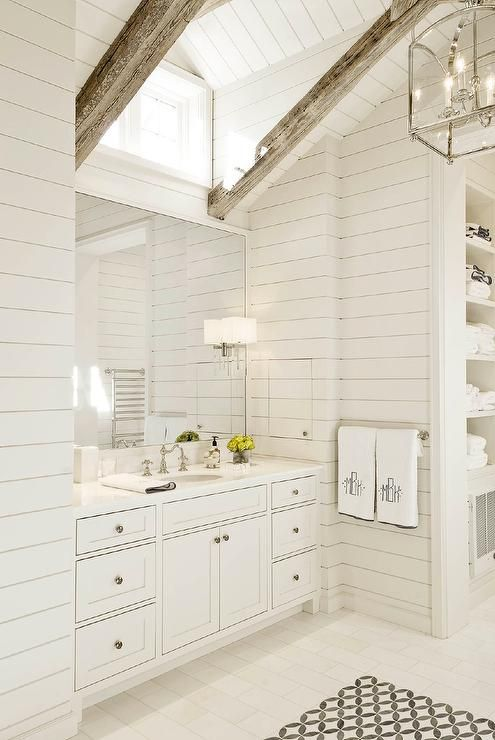 white master bathroom features a shiplap vaulted ceiling dotted with rustic wood beams accented