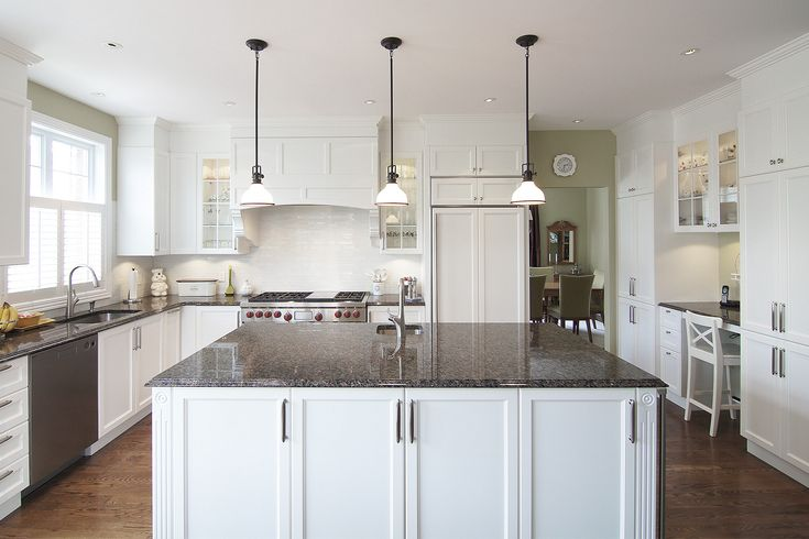 A design that is both luxurious and inviting, this kitchen is ergonomically conducive to meal preparation at its most productive. The white cabinets provide a stylish simplicity to the room.