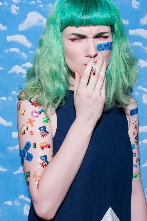 Green hair, face band-aid, temporary tattoos