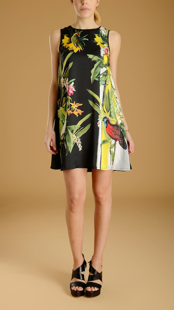 Black dress with natural print at front: flowers and birds. Round neckline, back concealed zip fastening.