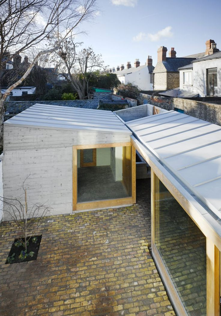 Donaghy + Dimond Architects, Ros Kavanagh Photographer · Laneway Wall Garden House