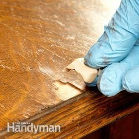 Repairing damaged furniture- Fill with epoxy putty. Once sanded, it stains like real wood