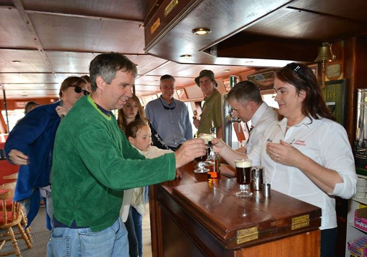 Douglas Kennedy sampling Award Winning Irish Coffee served by Róisín Sweeney Powers Irish Coffee making champion during his visit to Galway