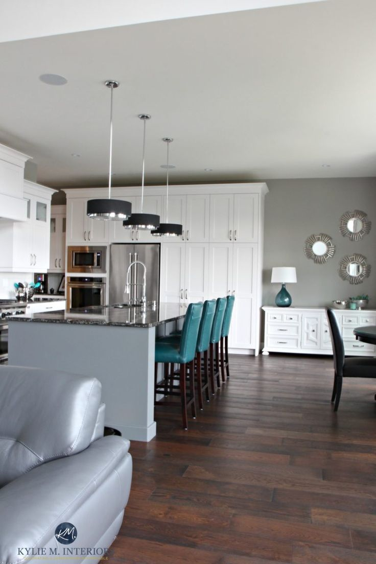 Open layout white kitch with gray painted island, teal accents. Sherwin Williams Dorian Gray. Kylie M Interiors E-decor, Online Consulting, decorating and design
