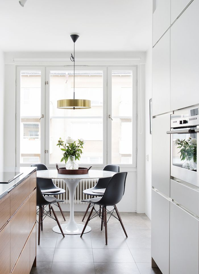 black white and wood table and chairs eat in kitchen