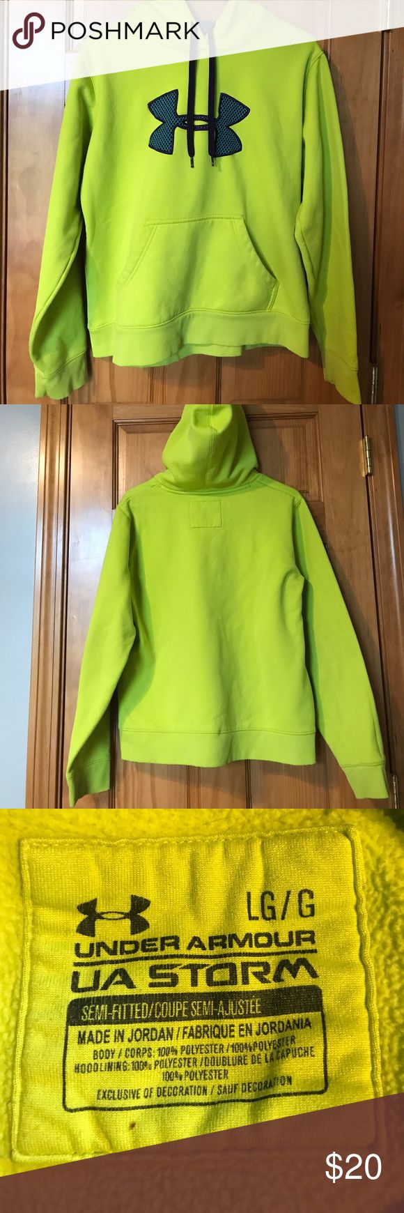Under Armor Sweatshirt Neon yellow with blue and purple Under Armor symbol.  Water resistant and very warm. There is a  very small stain on the front near the pocket which is pictured. Under Armour Tops Sweatshirts & Hoodies