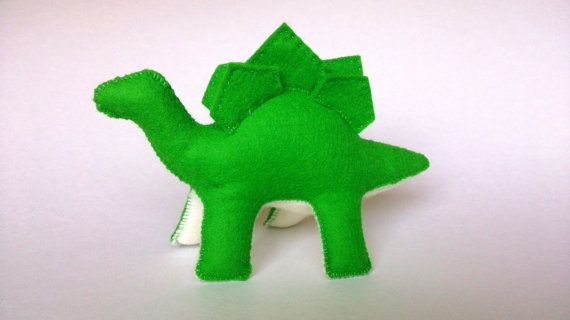 100% wool felt plush Stegosaurus by Mouse  Moose on Etsy.  A perfect eco friendly option for any dinosaur lover.  Custom colors available.  Pterodactyl, Triceratops, and Brontosaurus also sold separately.  Handmade in Vancouver, Canada.