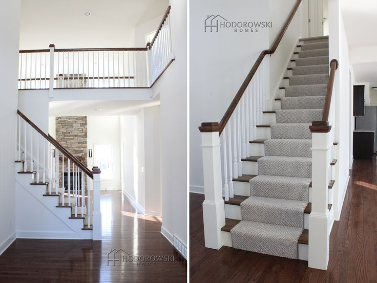 Gorgeous 2-story foyer from our Twenty West subdivision selected square newel posts painted white with stained caps.