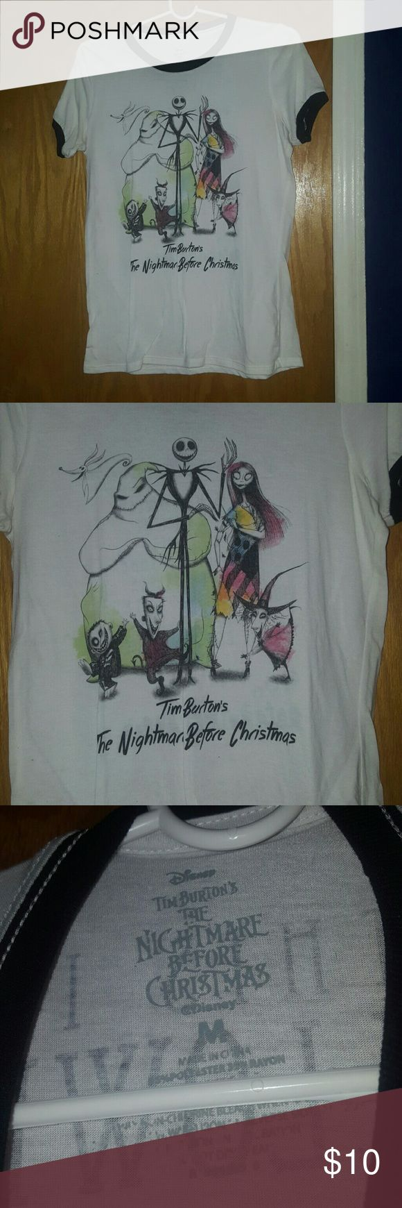 Nightmare before christmas shirt Selling a woman's nightmare before christmas  shirt size medium , worn a few times but still in good condition. Disney Tops Tees - Short Sleeve
