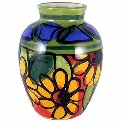 Handpainted Pottery By Kelly Jo Designs - Similar to Talavera, this pottery features colorful New Mexico motifs. Striking in color and design, yet functional enough for daily use. These stunning art pieces are fired in the North Albuquerque, NM studios of Kelly Jo Designs, then painstakingly handpainted, one by one.