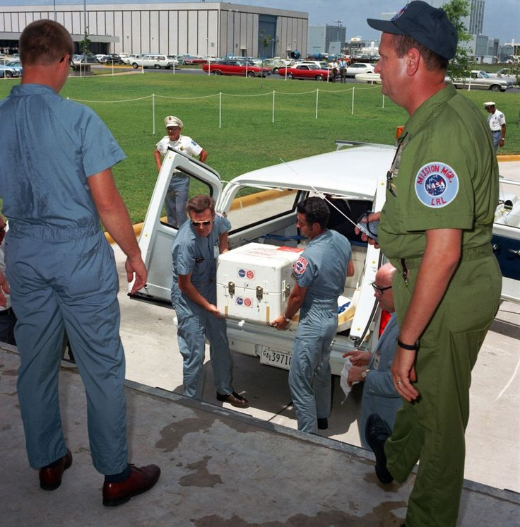 The first Apollo 11 sample return containers  are unloaded at the Lunar Receiving Laboratory  of the Manned Spacecraft Center in Houston.