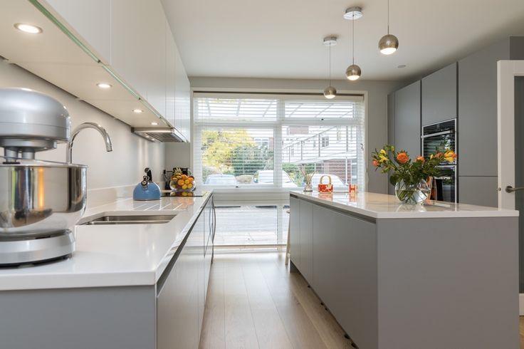 Handleless matt grey kitchen with Pearl grey kitchen base units and handleless matt white wall units.