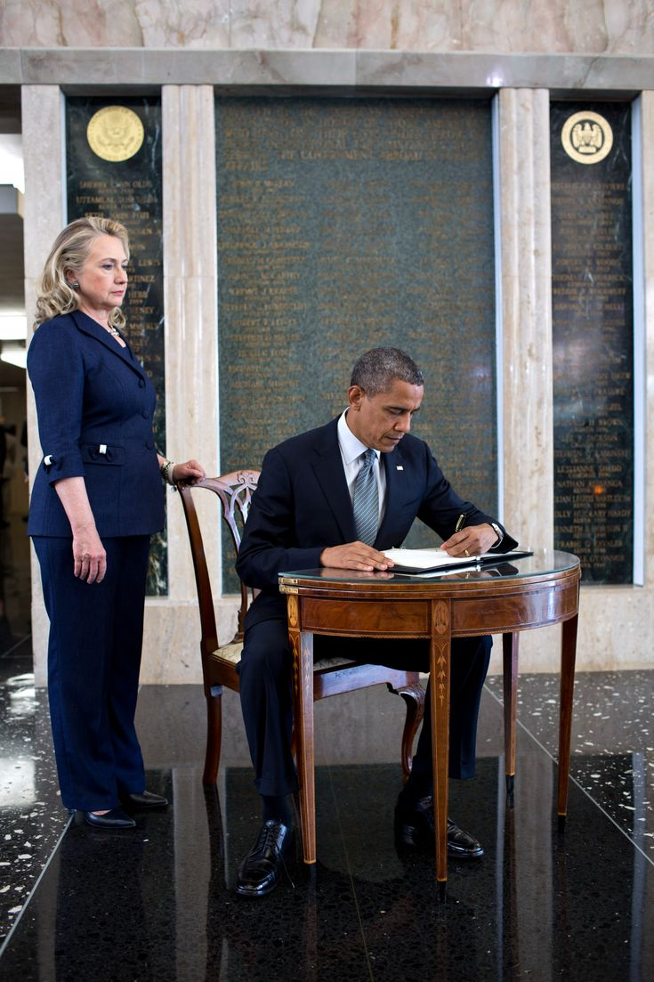 #44thPresident #BarackObama signs a condolence book September 12, 2012 in memory of Chris Stevens, U.S. Ambassador to Libya, after addressing State Department employees at the State Department in Washington, D.C., Sept. 12, 2012. Secretary of State Hillary Rodham Clinton stands at left. Amb. Stevens was killed September 11, 2012 along with three others at the consulate in Benghazi, Libya