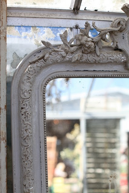 Carved / painted mirror from Atelier de Campagne.