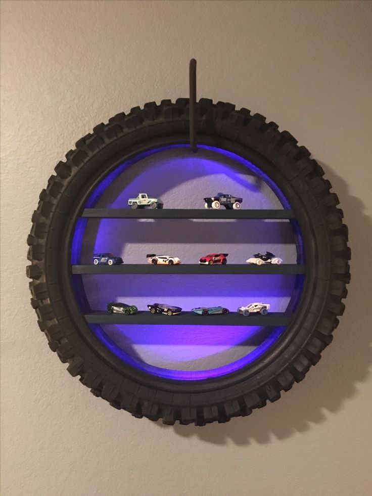 Dirt bike tire shelves with LEDs. Contact me if you are interested in purchasing one. Stefanie@ardor-innovations.com   I also do custom peg boards and 3D printing