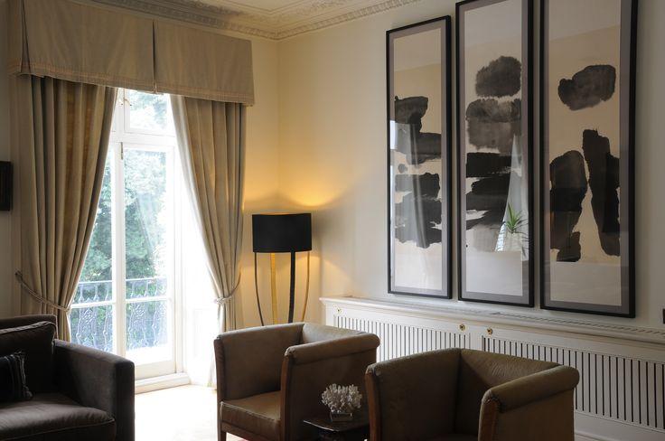 kensington house - Porta Romana lamp - cow hide Chairs