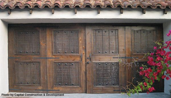 Traditional garage door with a double entry, iron door hardware, great stucco and a Spanish tile roof. Beautiful finishes on this remodel. Installation of a garage like this is not as hard as you think.