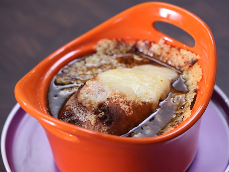 Food Network invites you to try this French Onion Soup with Porcini recipe from Rachael Ray.