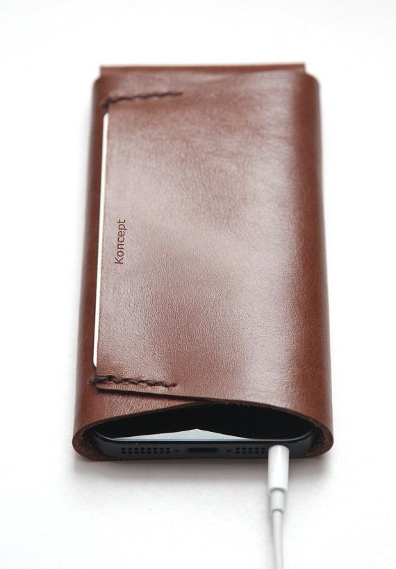 Buy Now & Get a Cable Holder FREE > This iPhone sleeve is a case and premium leather wallet in one. It is made from genuine leather and stitched